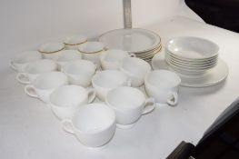 BOX CONTAINING WHITE GLAZED CHINA CUPS AND SAUCERS WITH SIDE PLATES