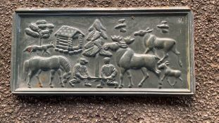 Heavy decorative cast metal Plaque depicting Nordic country lifestyle including reindeer log cabin