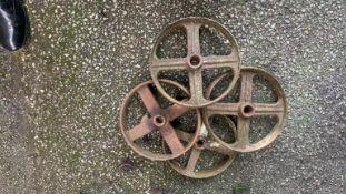 Four various cast iron Wheels