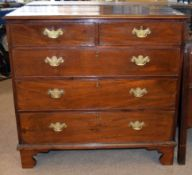 George III period mahogany chest of two and three drawers with engraved brass fittings, shaped