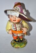 Late 18th century Derby Mansion House dwarf, the base incised No 227, the figure with large hat with