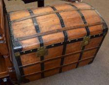 Late 19th century stained wood travelling trunk with metal and wood lath mounts to the domed lid and