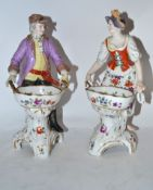Pair of Continental porcelain Berlin style sweetmeat figures of gentleman and lady, decorated with