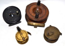 Box containing four fishing reels