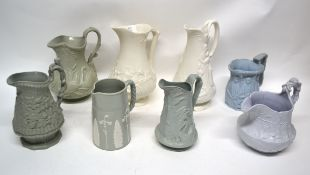 Group of 19th century pottery relief decorated jugs including Naomi and her daughters-in-law, one