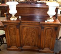 19th century mahogany break front sideboard, scroll moulded pediment over a shelf supported by