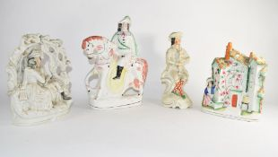 Group of four Staffordshire figures including an arbour group, and gentleman on horseback (4)