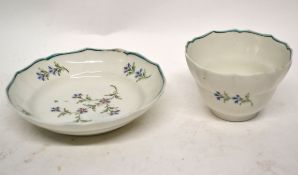 Lowestoft porcelain tea bowl and saucer, circa 1790, the tea bowl of ogee shape with decoration of
