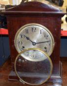 Mahogany cased mantel clock with German movement, circular Arabic chapter ring and bracket feet,