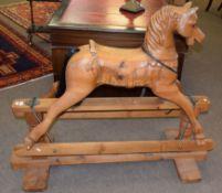 Good quality carved pine rocking horse with stretcher base, width 133cm x 57cm deep x 110cm high (