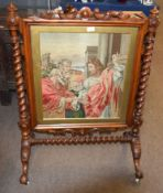 Victorian walnut large fire screen, central grospoint wool embroidered panel depicting a Biblical