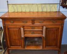 Late 19th century mahogany sideboard having brass rail and curtained back, two long and two short