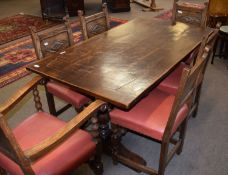 20th century small oak refectory style dining table with panelled top, turned baluster end supports,