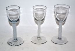 Group of three mid-18th century wine glasses with air twist stems (3)