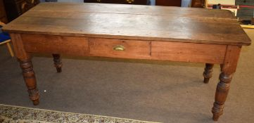 Stained pine kitchen table, of rectangular form with single frieze drawer raised on turned supports,
