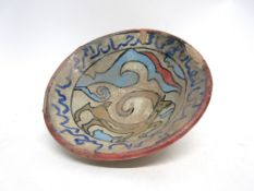 Flared pottery Islamic bowl decorated with a horse and geometric design, 14cm diam