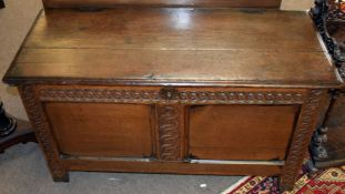 18th century oak coffer with staple fixed two-part top, wavy carved frieze and uprights, two plain