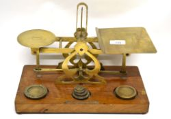 Set of postal scales with weights, on wooden mount, 33cm long
