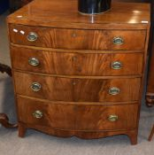 Late Georgian mahogany bow front chest of four graduated drawers with embossed oval brass handles,