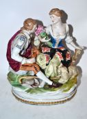 Continental porcelain figure group of a shepherdess with her suitor, 22cm high