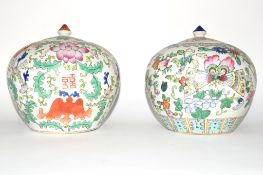 Two Chinese porcelain jars and covers decorated in polychrome with floral design (2)