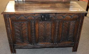 Oak coffer with three panel front and plain interior on stile feet 109cm wide