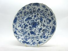 Chinese porcelain plate with a flowering design of plants in Kangxi style, with Kangxi motif to