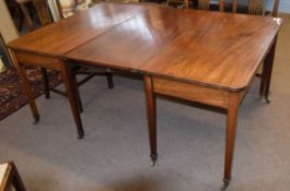 Georgian style mahogany D-end dining table with single centre leaf and brass clips, raised on