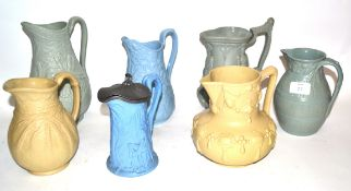 Group of 19th century relief moulded jugs including one with various European warriors, published by
