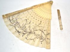 Box containing Oriental ivory fan