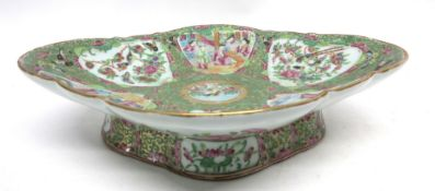 Large 19th century Cantonese dish of lobed shape decorated in typical fashion with panels of Chinese