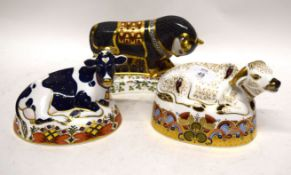 Group of three Royal Crown Derby paperweights with gold tops, including Friesian cow, Water