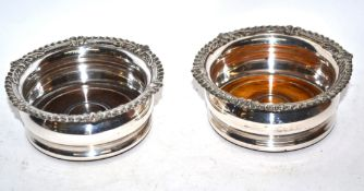 Pair of silver plated wine coasters