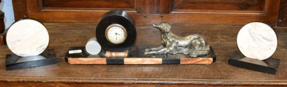 Art Deco period spelter and marble clock garniture, the central clock with metal dog motif, 46cm
