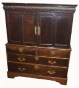 Early 18th century oak cabinet with chest base, having two inlaid double panelled doors beneath a