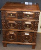 Jacobean style oak cabinet having plain lifting top above a moulded fronted dummy drawer, two double