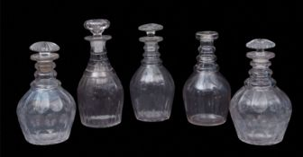 Group of four 19th century cut glass decanters with mushroom stoppers, together with a further