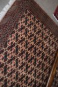 Modern Caucasian carpet, multi-gull border, central panel of geometric designs, mainly brown field