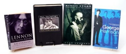 Collection of Beatles books, one on each Beatle, along with 'Unseen Photographs'.