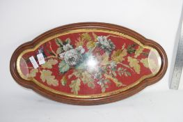 PIECE OF EMBROIDERY IN SHAPED MAHOGANY FRAME
