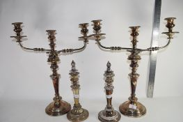 PAIR OF PLATED CANDELARBRA AND TWO FURTHER PLATED CANDLESTICKS