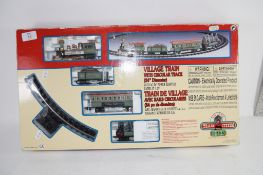 BOX CONTAINING A VILLAGE TRAIN SET WITH TRACK