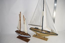 TWO SMALL MODELS OF A POND YACHTS ON WOODEN BASES
