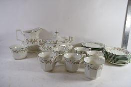 TEA WARES MADE BY JOHNSON COMPRISING SIX CUPS, SAUCERS, TEA POT ETC