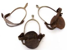Pair of 20th century military Cavalry spurs together with another single spur (a/f)