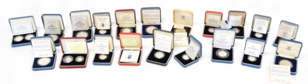 Quantity of individually cased silver proof coins/commemorative coins to include £1 coin, Queen's