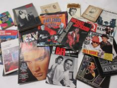 818b: Box of film, TV music interest including ELVIS, ROLLING STONES, FERRY ACROSS THE MERSEY THE