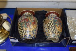 SMALL PAIR OF JAPANESE VASES, MODELLED IN RELIEF WITH JAPANESE CHARACTERS AROUND A HORSE