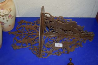 WOODEN WALL MOUNT WITH PIERCED DESIGN OF FIGURES