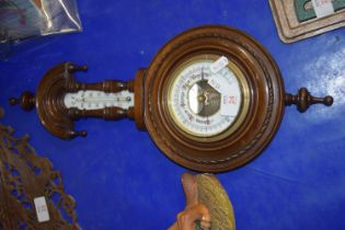 BAROMETER IN CIRCULAR MAHOGANY CASE WITH THERMOMETER ABOVE